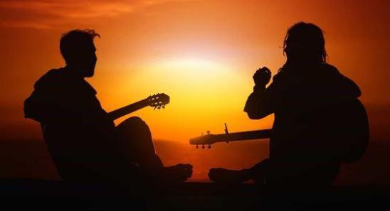 Guitarists At Sunset