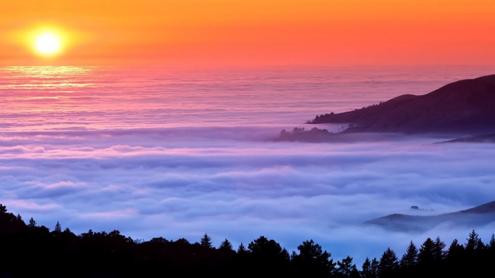 Sunset Over Clouds From Mountain Top